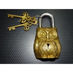 Indian padlock in the shape of a weathered golden owl