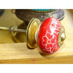 Red porcelain drawer handle and white flowers