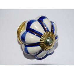 White pumpkin handles with blue and gold strokes