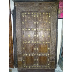 Old house doors with brass nails on the front