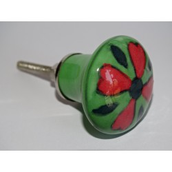 green pear shaped button and red flower