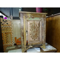 Patinated recycled white teak bedside table with carved flower door