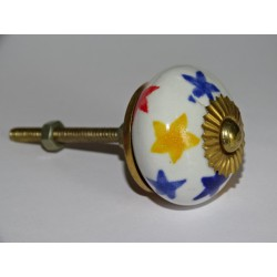 White drawer or door knobs and multicolored stars