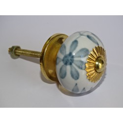 White drawer or door knobs with large gray flower