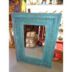Large mirror carved and patinated in turquoise 91 x 122 cm