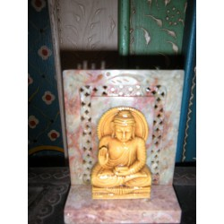 Little statue of Buddha sitting in resin